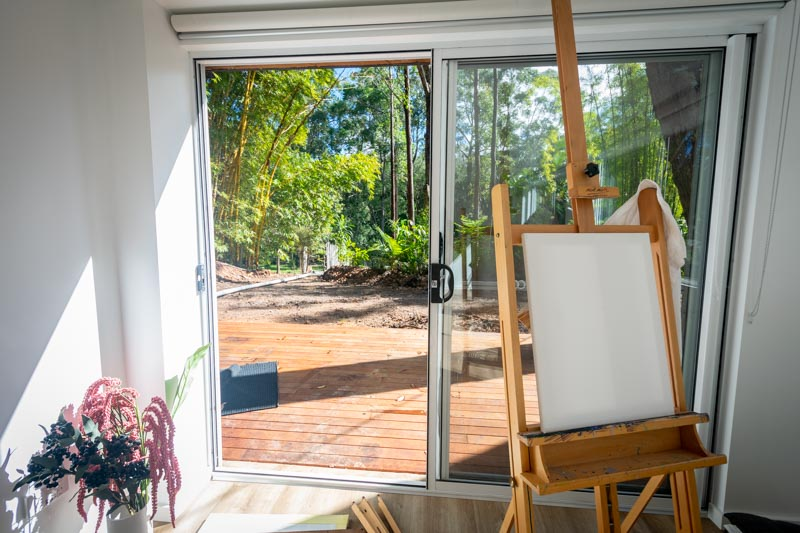 white canvas on easel with outdoor view